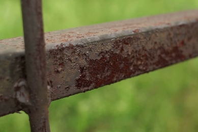 close-up-of-rusting-ornamental-wrought-iron-fencing